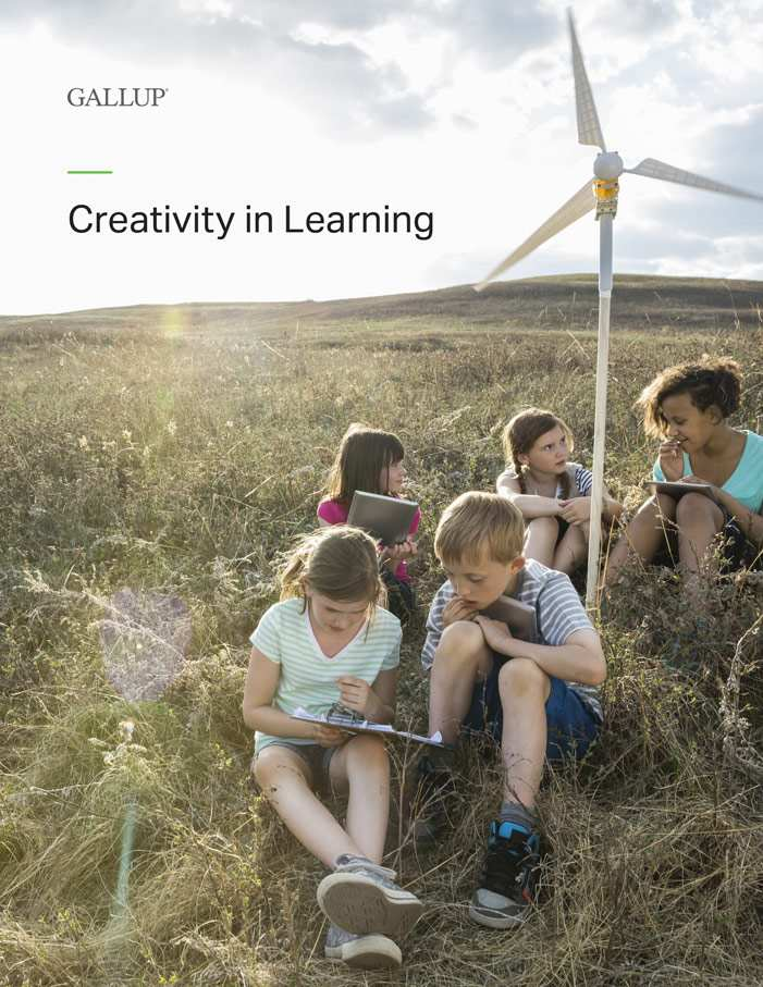 Report cover for Creativity in Learning featuring five children in a sun-drenched field studying a wind turbine.