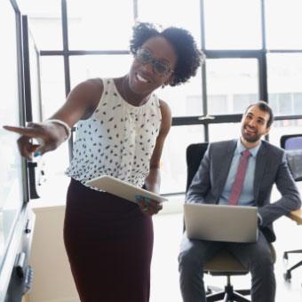 A business woman coaching a business man.