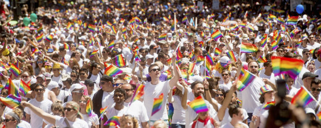 LGBT Americans Continue to Skew Democratic and Liberal