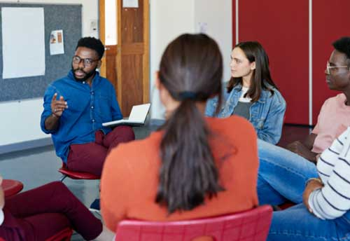 Small group of students sitting in a discussion circle