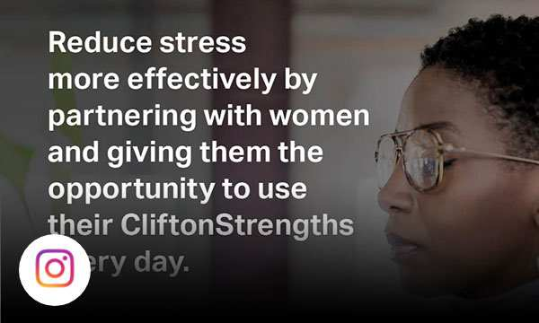 Woman writing on sticky notes on a wall with text reduce stress more effectively by partnering with women and giving them the opportunity to use their CliftonStrengths every day.